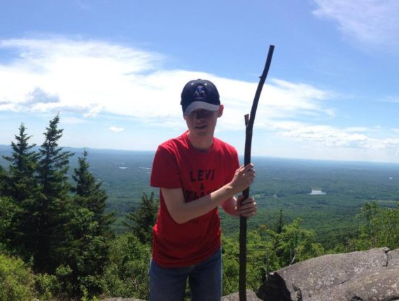 Tyler at the top of Mount Monadnock after a day of hiking with college friends.