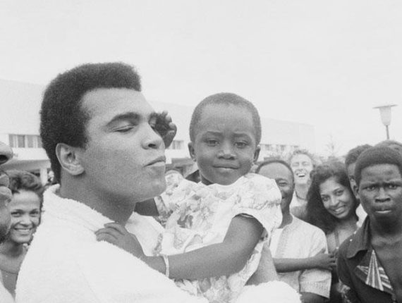 Muhammad Ali with a small child