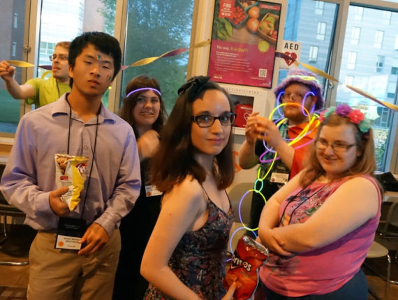 A group of young adults celebrating at the Party For PYD event