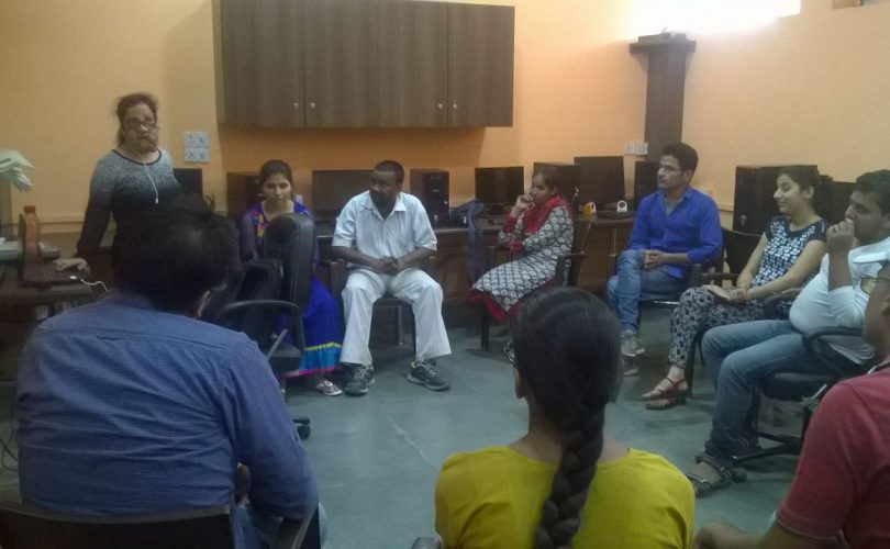 Vibhu speaking in front of a group circle
