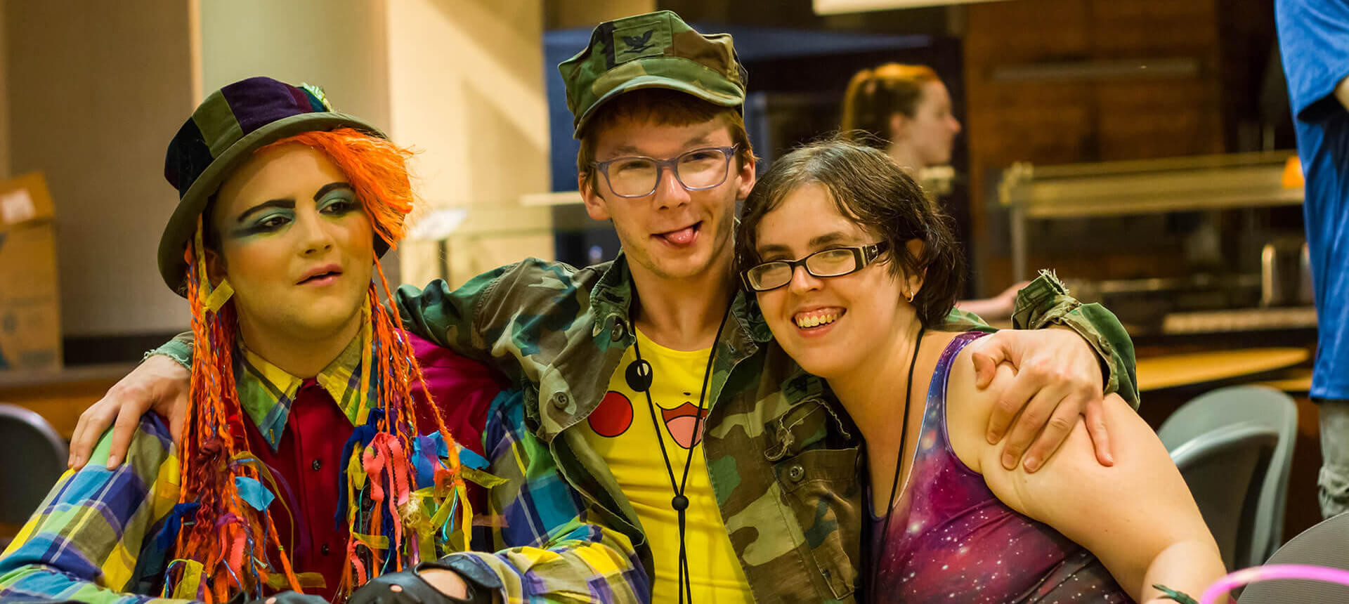 Young adults dressed in colorful costumes making funny faces