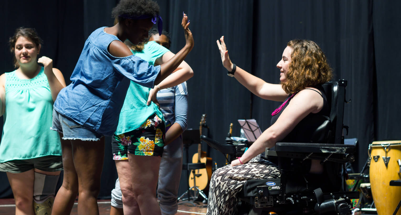 Two theater arts particiapants give each other a high five