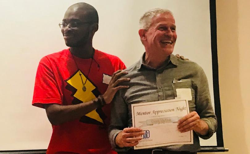 PYD mentor receiving award on Mentor Appreciation Night